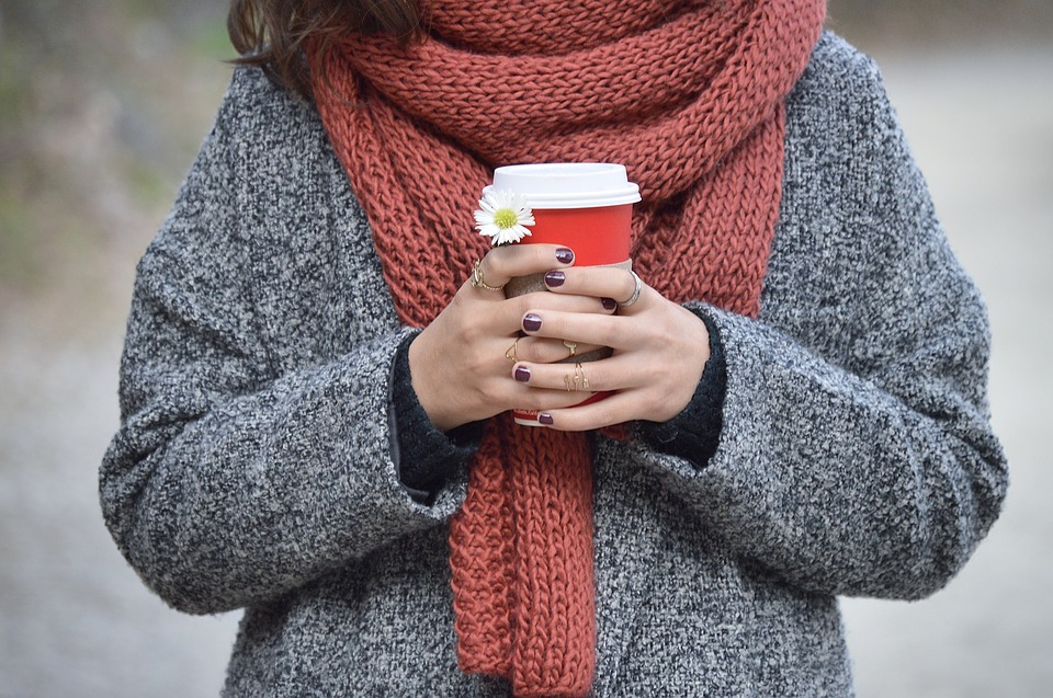 how to bring hygge to the office this winter tea cozy candle scarf sweater cold qs creative